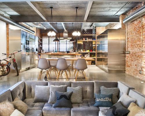 Huge Urban Formal And Open Concept Concrete Floor Living Room Photo In Barcelona With Orange Walls