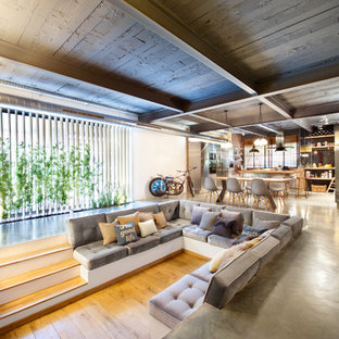 Large urban formal open plan living room in Madrid with multi-coloured walls, medium hardwood flooring, no fireplace and a wall mounted tv.