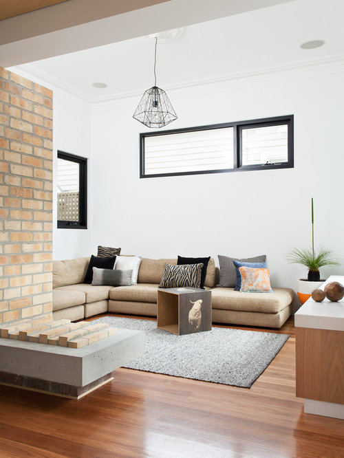 Example Of A Trendy Open Concept Medium Tone Wood Floor Living Room Design  In Melbourne With