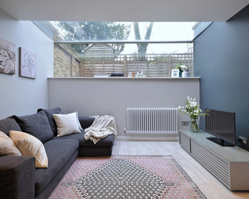 Design Ideas For A Contemporary Living Room In London With Grey Walls,  Light Hardwood Flooring