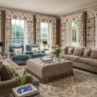 Design ideas for a medium sized traditional enclosed living room in Surrey with brown walls and beige floors.