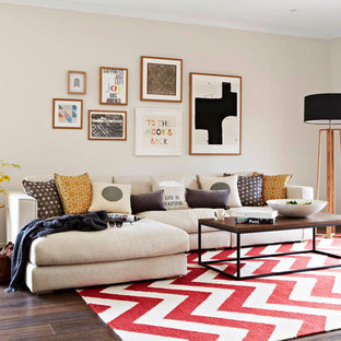 Living room - contemporary formal medium tone wood floor living room idea in Melbourne with beige walls