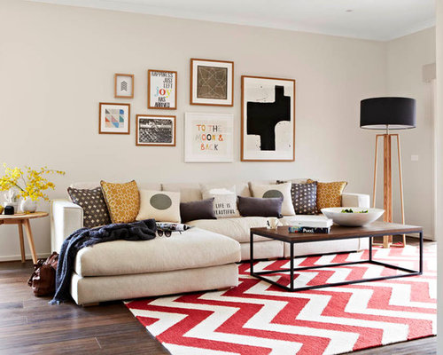 Contemporary Formal Medium Tone Wood Floor Living Room Idea In Melbourne With Beige Walls