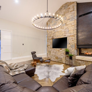 Inspiration for a large contemporary formal open concept living room in Perth with medium hardwood floors, a two-sided fireplace, a stone fireplace surround, a wall-mounted tv, beige floor and beige walls.