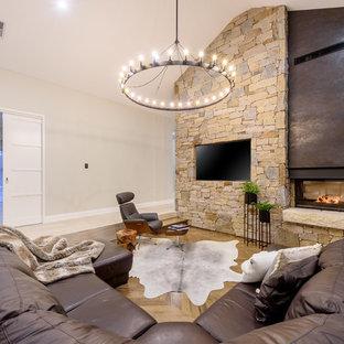 Immagine di un grande soggiorno minimal aperto con pavimento in legno massello medio, camino bifacciale, cornice del camino in pietra, TV a parete, pavimento beige, sala formale e pareti beige