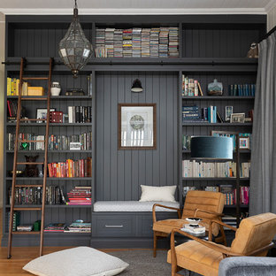 Photo of a transitional enclosed living room in Brisbane with a library, white walls, medium hardwood floors and brown floor.