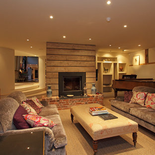 Inspiration for a mid-sized timeless enclosed carpeted living room remodel in Hampshire with a standard fireplace