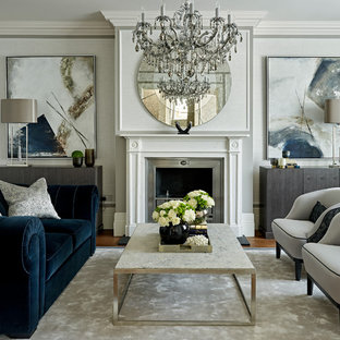 Living room - transitional formal and enclosed living room idea in London with no tv, a standard fireplace and gray walls