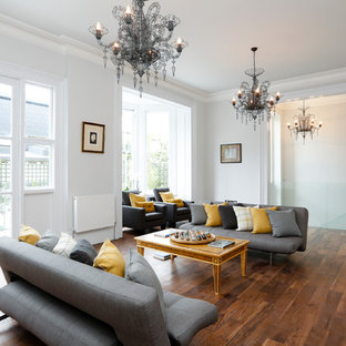 This Is An Example Of A Contemporary Living Room In Surrey With White Walls.