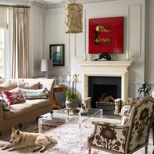 This is an example of a small traditional living room in London with grey walls, dark hardwood flooring, brown floors and a standard fireplace.
