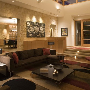 Example of a huge trendy open concept light wood floor living room design in Austin with white walls
