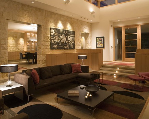 Example of a huge trendy open concept light wood floor living room design  in Austin with