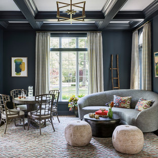 Example of an eclectic enclosed dark wood floor living room design in New York with blue walls