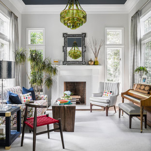 Example of an eclectic formal and enclosed dark wood floor living room design in New York with gray walls, a standard fireplace and a brick fireplace