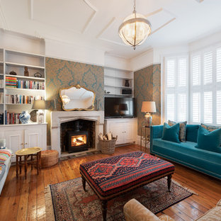 Inspiration for a medium sized classic living room in London with white walls, medium hardwood flooring, a wood burning stove and brown floors.