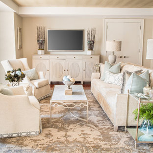 Mid-sized transitional open concept medium tone wood floor living room photo in Boston with beige walls, no fireplace and a wall-mounted tv