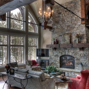 ミネアポリスのラスティックスタイルのおしゃれなリビング (フォーマル、標準型暖炉、石材の暖炉まわり) の写真