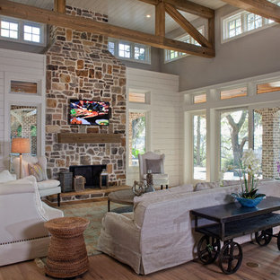 75 most popular tropical living room with a stone fireplace design rh houzz com
