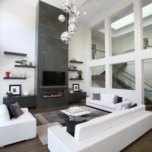 Living room - contemporary open concept dark wood floor living room idea in Toronto with white walls, a ribbon fireplace and a wall-mounted tv