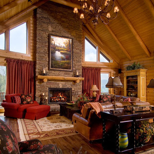 Example of a large mountain style formal and open concept medium tone wood floor living room design in Huntington with brown walls, a standard fireplace, a stone fireplace and no tv