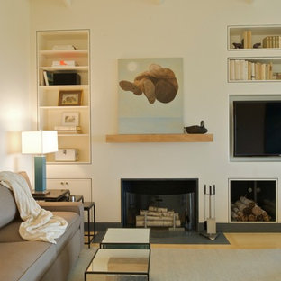 Design ideas for a small nautical open plan living room in Boston with bamboo flooring, a standard fireplace, a plastered fireplace surround and a wall mounted tv.