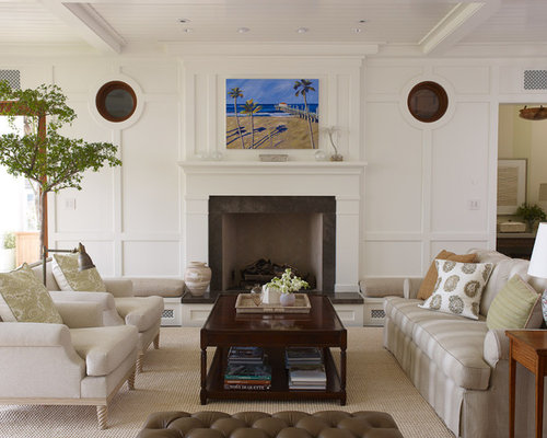 Example Of An Island Style Enclosed Living Room Design In Los Angeles With White Walls And