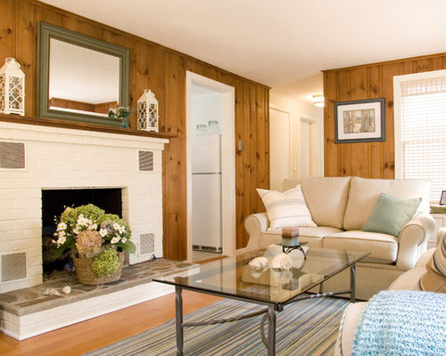 Inspiration For A Mid Sized Timeless Enclosed Medium Tone Wood Floor Living Room Remodel In
