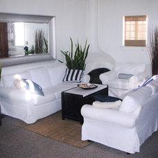 Tropical Living Room by Newport Balboa Design