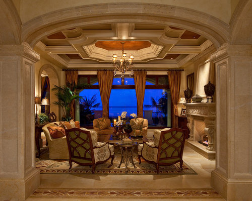Tuscan Beige Floor Living Room Photo In Miami With Beige Walls And A  Standard Fireplace