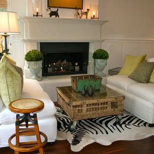 Example of a beach style dark wood floor living room design in Los Angeles with white walls and a standard fireplace