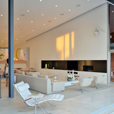 Beach Style Living Room by West Chin Architects & Interior Designers