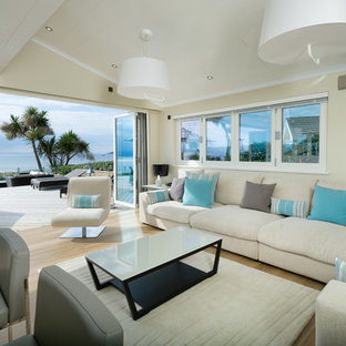 Inspiration for a coastal formal open plan living room in Other with yellow walls, light hardwood flooring and beige floors.