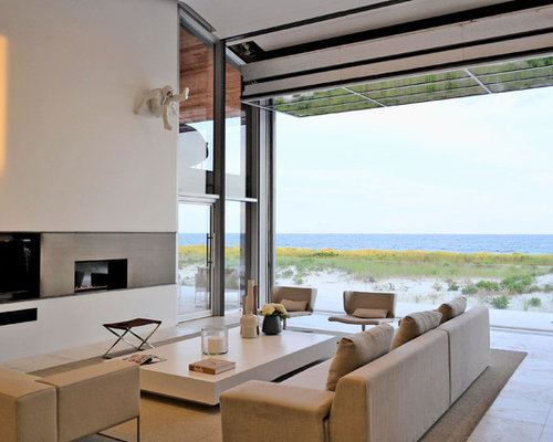 Beach style modern fireplace with glass home design for Modern beach house living room