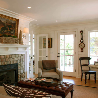 Example of a mid-sized beach style formal and enclosed medium tone wood floor living room design in New York with a stone fireplace, white walls and a standard fireplace