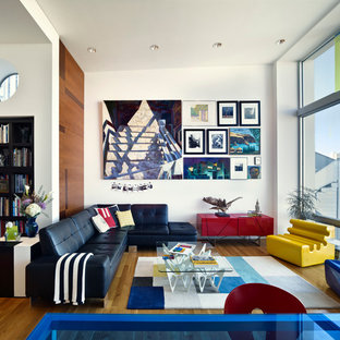 Example of a mid-sized eclectic formal and open concept medium tone wood floor living room design in San Francisco with white walls and no tv