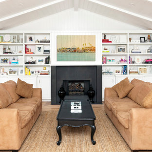 Inspiration for a coastal living room remodel in Los Angeles with white walls
