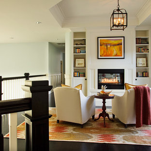 Example of a coastal loft-style living room library design in Portland