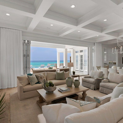 Huge beach style open concept light wood floor living room photo in Miami with white walls, a standard fireplace, a tile fireplace and a wall-mounted tv