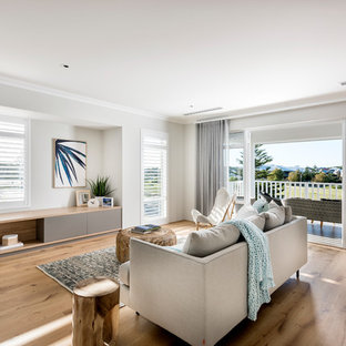 Inspiration for a coastal light wood floor and beige floor living room remodel in Perth with gray walls and no tv