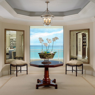 Living room - beach style living room idea in Miami with beige walls