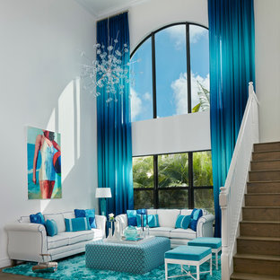 Large coastal formal and open concept dark wood floor living room photo in Miami with white walls
