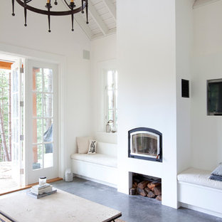 Inspiration for a beach style living room remodel in Vancouver with white walls and a standard fireplace
