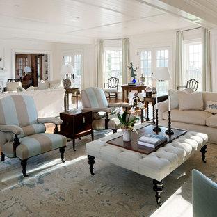 Coastal open concept medium tone wood floor living room photo in Boston with white walls