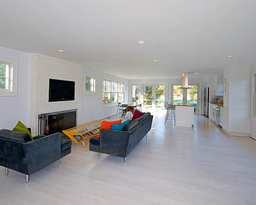 Coastal Open Concept White Floor Living Room Photo In New York With A  Wall Mounted