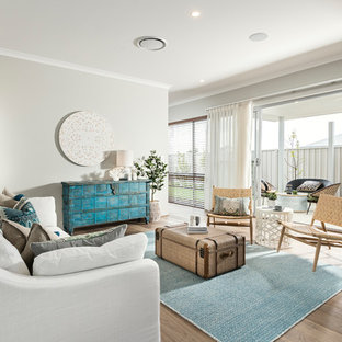 Inspiration for a beach style formal enclosed living room in Perth with grey walls, medium hardwood floors and brown floor.