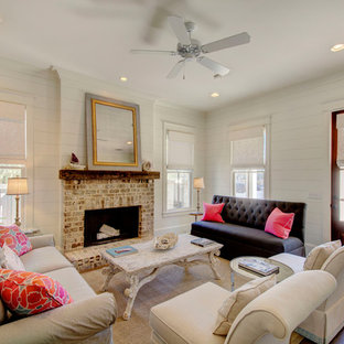 Inspiration for a beach style formal and enclosed medium tone wood floor and brown floor living room remodel in Dallas with white walls, a standard fireplace and a brick fireplace