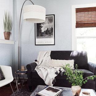 Example of a coastal dark wood floor and brown floor living room design in Denver with gray walls