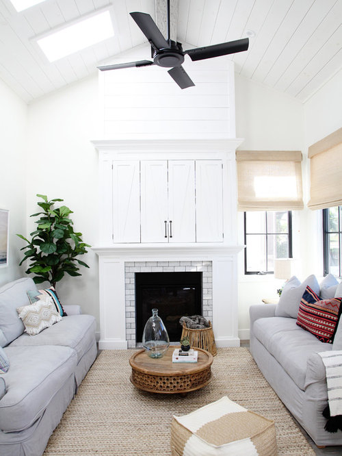 living room beach style formal and open concept gray floor living room idea in los - Vaulted Ceiling