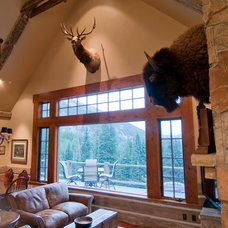 Rustic Living Room by Somrak Concept and Structure, Inc.