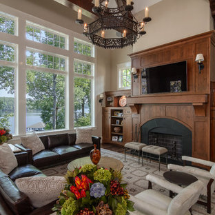 Mountain style dark wood floor and brown floor living room photo in Charlotte with beige walls, a standard fireplace and a tile fireplace